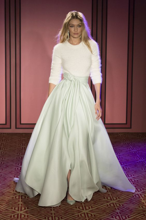 Brandon Maxwell 2018 collection shows again how to mix shapes and textures by adding a soft knit to silk structured A Line Skirt. A Very Achievable look!